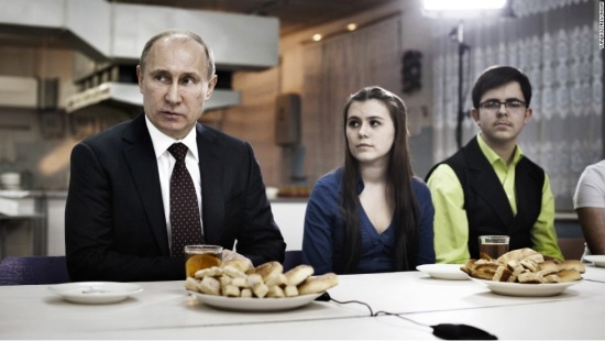 "(The Putin campaign's ""Have Dinner with Vladimir Putin!"" events are more somber than their American counterparts. Guests are asked not to smile and only bread is served. via CNN.com)"