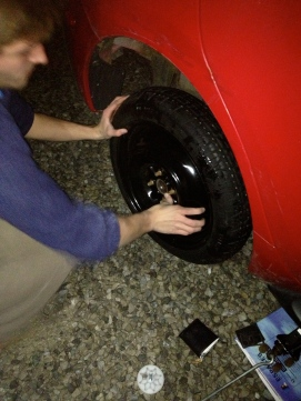 Put the donut on, retighten the bolts, doing them incrementally (if you tighten them one at a time the tire won't be balanced).