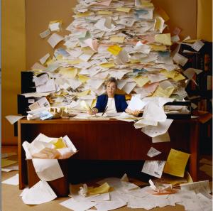 [http://thechaoswhisperer.files.wordpress.com/2012/08/paper-covered-desk.jpg]
