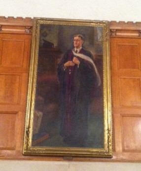 "William ""Foster"" Peirce standing like Dumbledore at the front of the Great Hall"