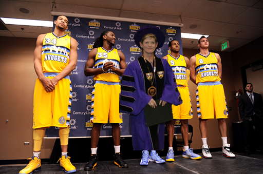"President S. ""Georgia"" Nugent wearing her inauguration robe, if she were also a member of the Nuggets"