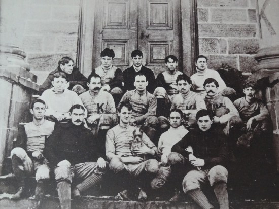 The Lords of 1895 with their star player, who appears to be a terrier.