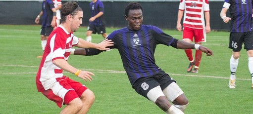 Kenyon Soccer Player Tony Amolo '17 and player from La Roche College