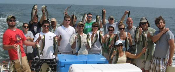This family caught a lot of fish. What are YOU doing with your family? Probably something with fewer fish maybe.
