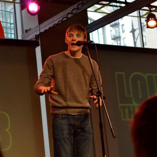 Henry at a slam poetry event in Chicago, no doubt performing a piece just as powerful/if not more so than this.