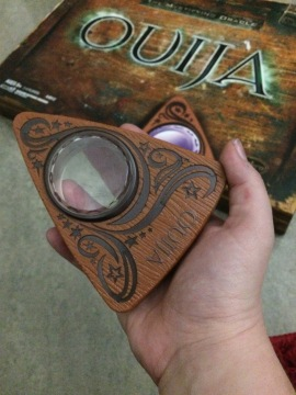 This planchette is made entirely out of plastic.