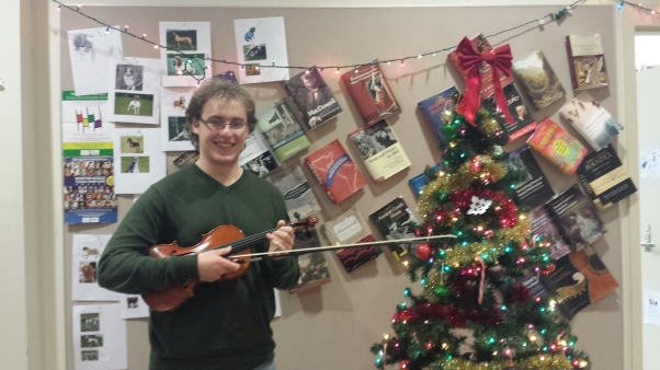 The Music Man himself with violin in hand in seasonally spruced-up Storer Lounge.