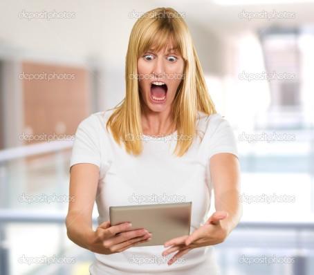 depositphotos_14053730-stock-photo-shocked-woman-looking-at-digital.jpg