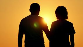 romantic-silhouette-young-couple-man-approaches-his-girlfriend-embrace-sunset-concept-love-99559864