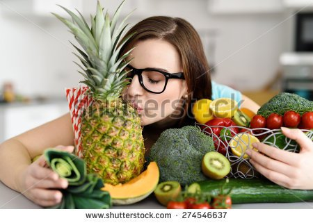stock-photo-young-woman-wearing-eyeglasses-with-black-frames-embracing-variety-of-fruits-and-vegetables-and-274546637-1