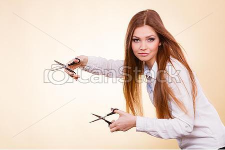 crazy-girl-with-scissors-hairdresser-in-stock-images_csp45788355.jpg